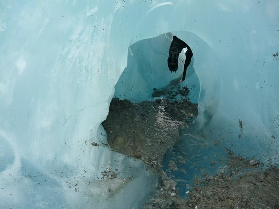 Franz Josef Glacier Guides: Crawling through an ice cave (this was optional on our trip)!
