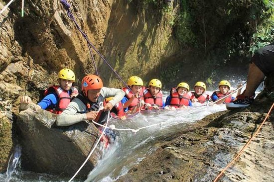 Hardcore Nepal Extreme Adventures - Day Tours : Canyoning group.  Safety ropes help you go confidently through this beautiful canyon.