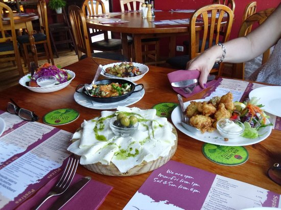 Tapas Pato de Oro: From left to right, side salad, roast vegetables, prawns in garlic, goat's cheese and battered f