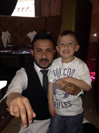 Lala's Restaurant: Elliot with Malik, who made a real fuss of him during our visit