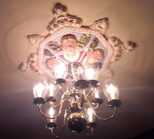Queen Anne Hotel: One of the ornate Chandeliers in the Dining area