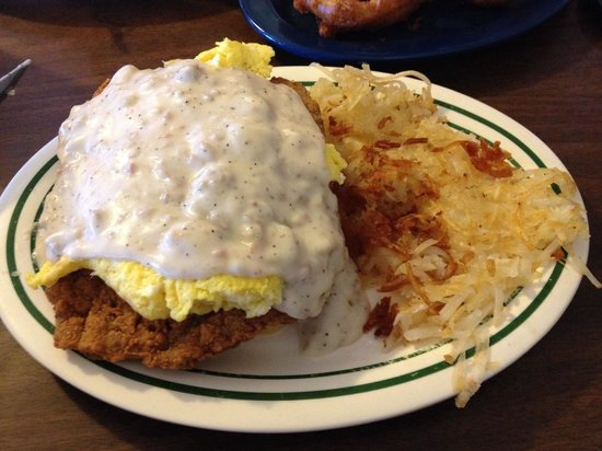 Mountain Shadows Restaurant: Eggs on chicken fried steak on a biscuit covered in sausage gravy!
