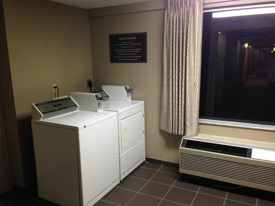 Sleep Inn & Suites Riverfront - Ellenton: Washer and dryer at end of the hall.