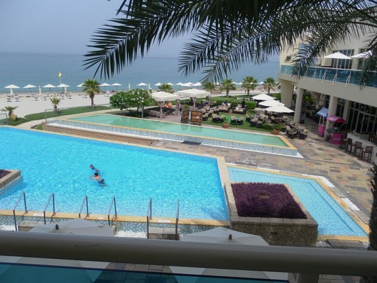 Radisson Blu Resort Fujairah: The view from our balcony across pools and beach