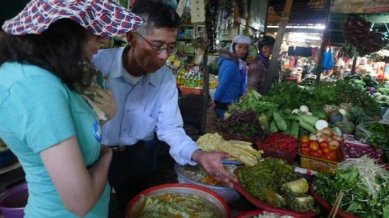 Hue Rider - Day Tours : In a local market
