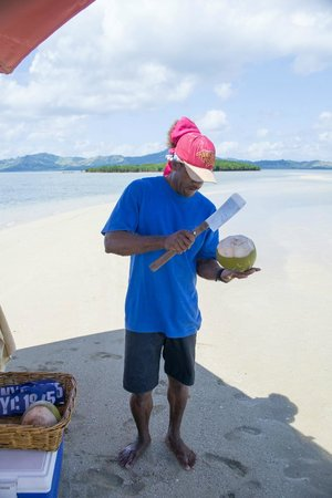 Nukubati Private Island: Sandbank picnic - he opened the coconuts for us before leaving us for several hours