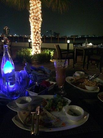 Khalidiya Palace Rayhaan by Rotana : Beach Restaurant at the night.