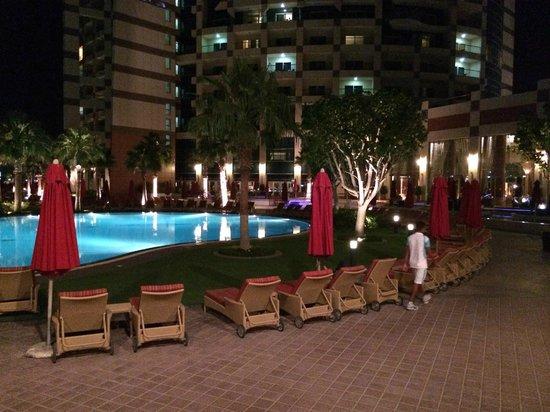 Khalidiya Palace Rayhaan by Rotana : Pool area at night.
