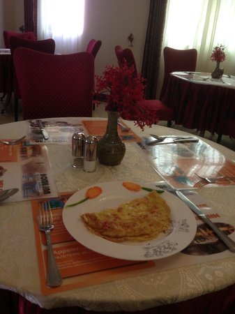 Home Inn: A nicely presented cheese and tomato omelette - breakfast