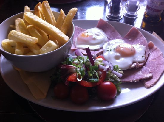 The Blue Bell Inn: home-cooked, hand-carved ham and free-range eggs with chips and salad garnish