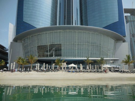 Jumeirah at Etihad Towers: Poolside at the foot of the towers