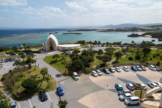 ANA InterContinental Manza Beach Resort: Room view parking lot (Ocean side) with the hotels Chapel
