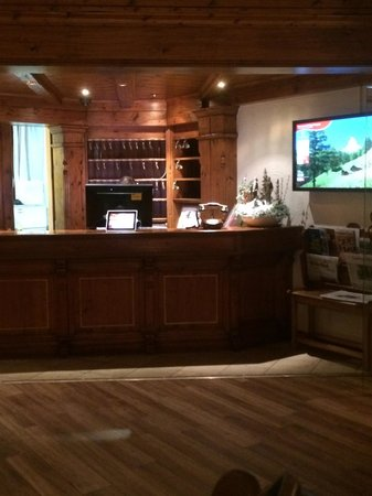 Hotel National Zermatt : Reception. The TV on the right is touchscreen so you can navigate through to the weather and oth