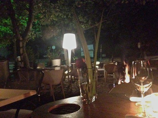 The hungry monk: Outside seating area at night