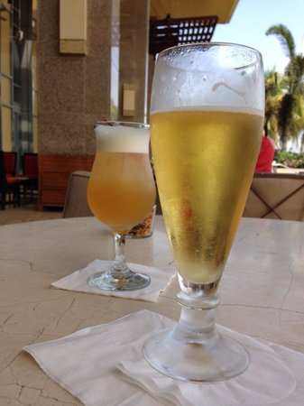 Hyatt Regency Trinidad: Draft Beer and Amaretto Sour , on a sunny day at the Hyatt