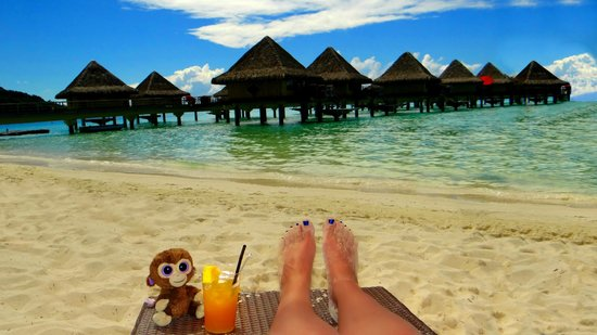 InterContinental Bora Bora Le Moana Resort : Our spot on the beach - with beverage!