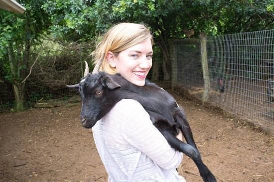 Leilani Farm Sanctuary: holding a kid at Leilani