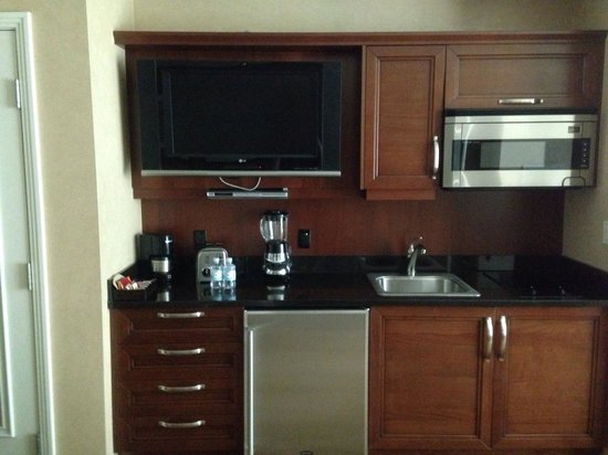 Signature at MGM Grand: Kitchen area with TV. Kitchen has utensils and other necessities.