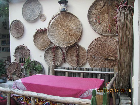 Caravan : Rustic baskets on walls of restaurant