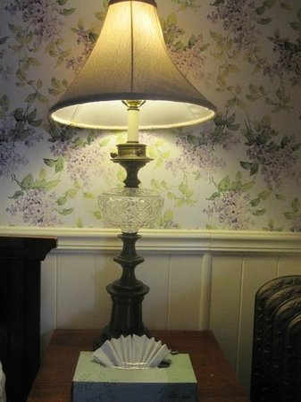 Inn at St. John: oil lamp with lilac wallpaper