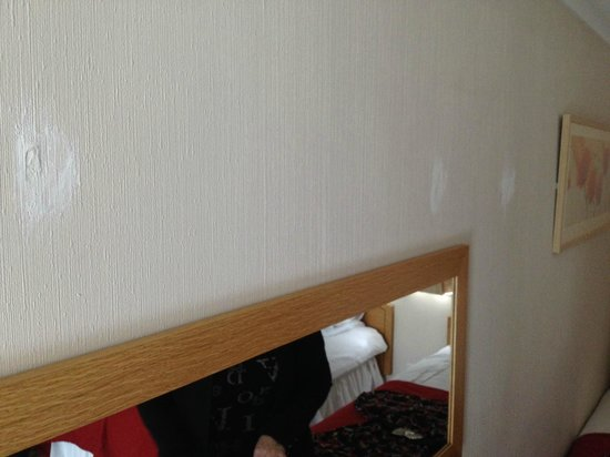 """The Links Country Park Hotel & Golf Club: 3 """"bodged"""" hole repairs in the wall in £166/night room."""