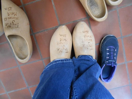 Windmill Island Gardens: Trying on wooden shoes