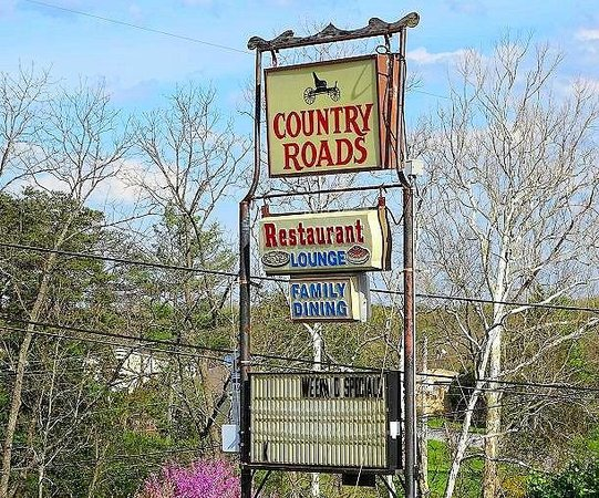 Country Roads Restaurant : sign on street