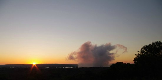 Rainbow Hotel Victoria Falls: Plumes from the Vic Falls as seen from the roof deck at Sunrise