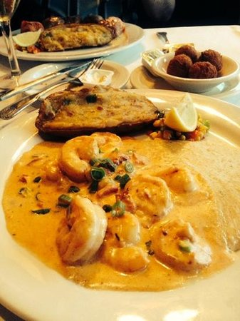 Louisiana Lagniappe : shrimp and grits served with. hush puppies and cajun potato
