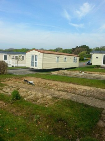 Shorefield Country Park: View of the holiday home from across the park