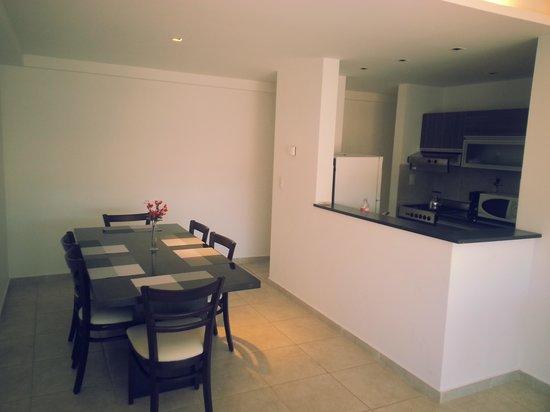 Amerian Carlos Paz Apart & Suites: living comedor