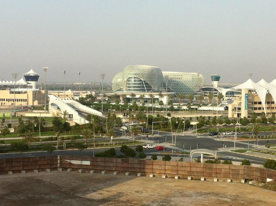 Centro Yas Island Abu Dhabi by Rotana : view from room 653 corridor window at other side of hotel, over to Formula 1 racetrack and Vicer