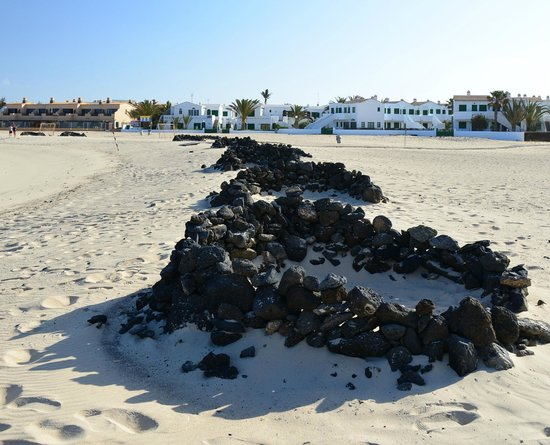 Cotillo Sunset: Volcanic dens on the beach to protect from the wind