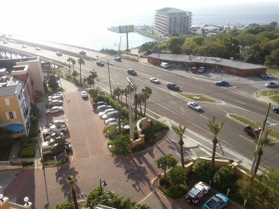 Emerald Grande at HarborWalk Village: View from master bedroom balcony of parking lot and busy intersection of 98