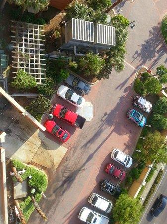 Emerald Grande at HarborWalk Village: View of parking lot beneath the master bedroom balcony