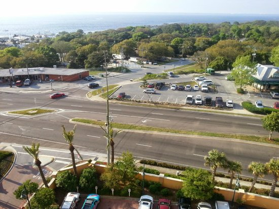 Emerald Grande at HarborWalk Village : View from master bedroom balcony across the street to McGuire's parking lot