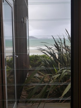 Curio Bay Accommodation : View from bath at Beachhouse Apartment