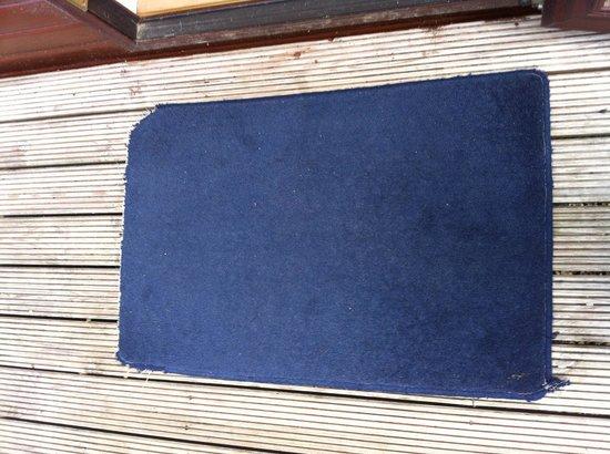Woodland Waters: Door mat from lodge