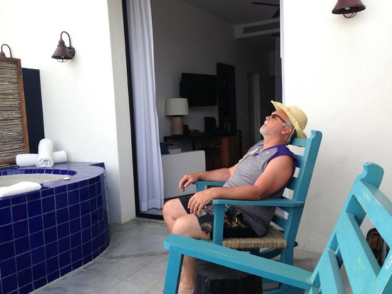 Hotel El Ganzo: My best friend watching the fishermen at the marina.  Tip, book a room on the bottom floor with