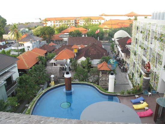 Ion Bali Benoa Hotel: Rooftop view of pool looking toward the main road and huge resorts that cost a lot more than the