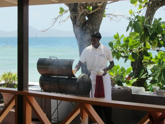 The French Verandah Restaurant: The meats on the BBQ pit outside tempting us with the scents!