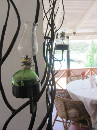 The French Verandah Restaurant: Unique kerosene lamps hung onto wrought-iron branches as decor. Unique!