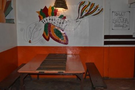 Marleys Guesthouse: dining table with art work