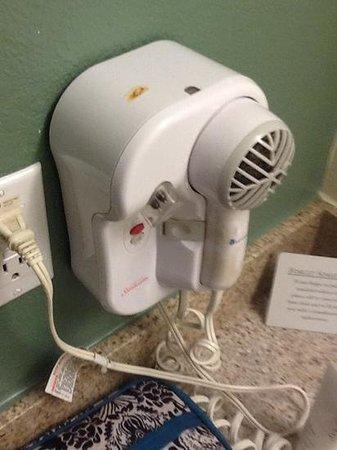 Quality Inn & Suites: cigarette burn on hair dryer
