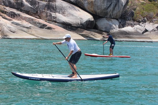 Samui Ocean Sports & Yacht Charter: 2 of us SUPing along side the boat on Koh Phangan