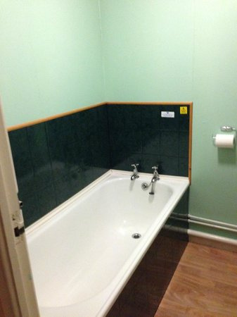 Whitecliff Bay Holiday Park: Old 1950s tin bath, not even a shower attachment