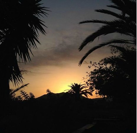 Las Gangarras: View from our table - Sun setting behind teide.