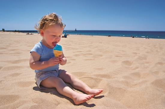 A boy and his Blue Moon ice cream on a Ludington beach.