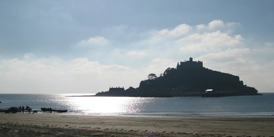 St. Michael's Mount: The Mount on a winter morning - the local gig rowers coming ashore on the bottom left