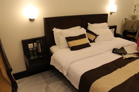 Hotel Taj Resorts: Cama de la habitación